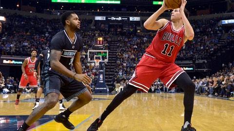 Chicago Bulls forward Doug McDermott (11) turns to shoot against Memphis Grizzlies guard Troy Daniels (30) in the second half of an NBA basketball game Sunday, Jan. 15, 2017, in Memphis, Tenn. (AP Photo/Brandon Dill)