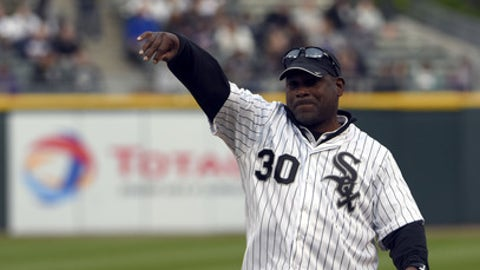 Former Major League Baseball player Tim Raines throws out a ceremonial first pitch before a baseball game between the Chicago White Sox and the Kansas City Royals, Friday, May 20, 2016, in Chicago. (AP Photo/David Banks)