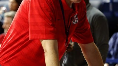 Arizona Vice President for Athletics, Greg Byrne during the first half of an NCAA college basketball game against Gardner Webb, Tuesday, Dec. 2, 2014, in Tucson, Ariz. (AP Photo/Rick Scuteri)