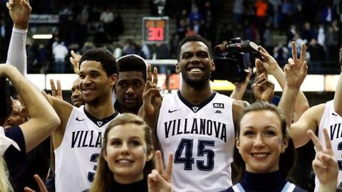 Villanova's Josh Hart, from left, Kris Jenkins and Darryl Reynolds celebrate after winning an NCAA college basketball game against Seton Hall, 76-46, Monday, Jan. 16, 2017, in Villanova, Pa. (AP Photo/Matt Slocum)