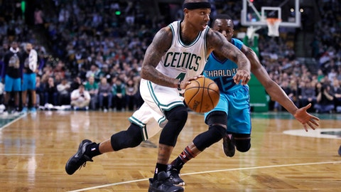 Boston Celtics guard Isaiah Thomas (4) drives to the basket past Charlotte Hornets guard Kemba Walker (15) during the first quarter of an NBA basketball game in Boston, Monday, Jan. 16, 2017. (AP Photo/Charles Krupa)
