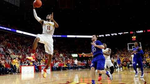 Iowa State guard Monte Morris (11) drives to the basket ahead of Kansas guard Sviatoslav Mykhailiuk (10) during the second half of an NCAA college basketball game, Monday, Jan. 16, 2017, in Ames, Iowa. (AP Photo/Charlie Neibergall)