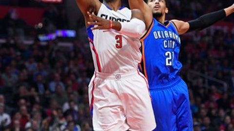 Los Angeles Clippers guard Chris Paul, left, shoots as Oklahoma City Thunder forward Andre Roberson defends during the first half of an NBA basketball game, Monday, Jan. 16, 2017, in Los Angeles. (AP Photo/Mark J. Terrill)