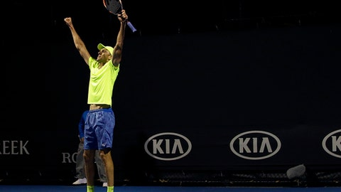 Croatia's Ivo Karlovic celebrates after defeating Argentina's Horacio Zeballos during their first round match at the Australian Open tennis championships in Melbourne, Australia, Tuesday, Jan. 17, 2017. (AP Photo/Aaron Favila)