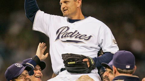 FILE - In this June 6, 2007, file photo, San Diego Padres closer Trevor Hoffman is hoisted by teammates David Wells, right, and Heath Bell after saving his 500th career game in the Padres 5-2 victory over the Los Angeles Dodgers in a baseball game in San Diego. Tim Raines and Jeff Bagwell are likely to be voted into baseball's Hall of Fame on Wednesday, Jan. 18, 2017, when Trevor Hoffman and Ivan Rodriguez also could gain the honor.  (AP Photo/Lenny Ignelzi, File)