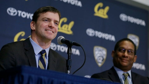 California head football coach Justin Wilcox, left, answers questions as Director of Athletics Mike Williams, right, listens during a news conference Tuesday, Jan. 17, 2017, in Berkeley, Calif. California officially introduced Wilcox, hoping the long-time defensive coordinator can help revive the struggling program. (AP Photo/Eric Risberg)