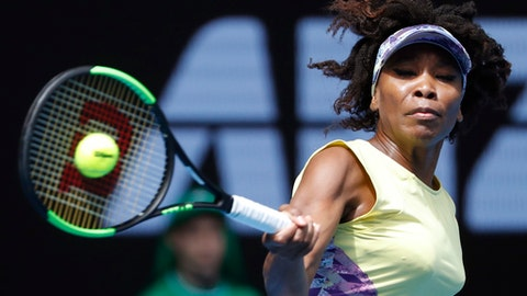 United States' Venus Williams hits a forehand return to Switzerland's Stefanie Voegele during their second round match at the Australian Open tennis championships in Melbourne, Australia, Wednesday, Jan. 18, 2017. (AP Photo/Dita Alangkara)