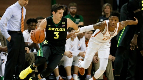 Baylor guard Jake Lindsey (3) moves the ball around the perimeter as Texas head coach Shaka Smart watches Kerwin Roach Jr. (12) defend in the first half of an NCAA college basketball game, Tuesday, Jan. 17, 2017, in Waco, Texas. (AP Photo/Tony Gutierrez)