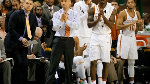 Texas head coach Shaka Smart and the bench cheer on after a basket against Baylor in the first half of an NCAA college basketball game, Tuesday, Jan. 17, 2017, in Waco, Texas. (AP Photo/Tony Gutierrez)