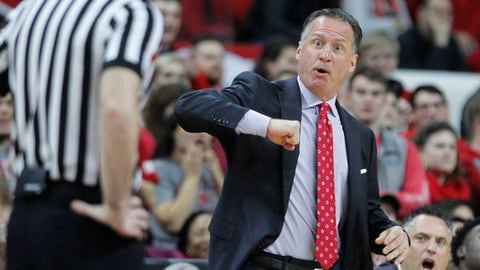 North Carolina State's head coach Mark Gottfried doesn't like the call by the official during the first half of an NCAA college basketball game against Pittsburgh in Raleigh, N.C., Tuesday, Jan. 17, 2017. (Ethan Hyman/The News & Observer via AP)
