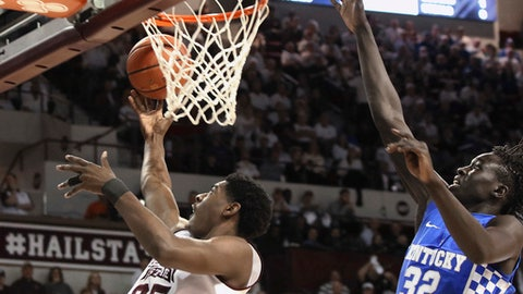 Mississippi State forward Aric Holman (35) shoots a layup ahead of Kentucky forward Wenyen Gabriel (32) during the first half of an NCAA college basketball game in Starkville, Miss., Tuesday, Jan. 17, 2017. (AP Photo/Jim Lytle)