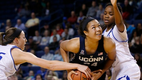 Tulsa forward Liesl Spoerl, left, reaches in to knock the ball away from Connecticut's Napheesa Collier, center, as Tulsa's Shug Dickson, right, defends duirng the second quarter of an NCAA college basketball game in Tulsa, Okla., Tuesday, Jan. 17, 2017. (AP Photo/Sue Ogrocki)