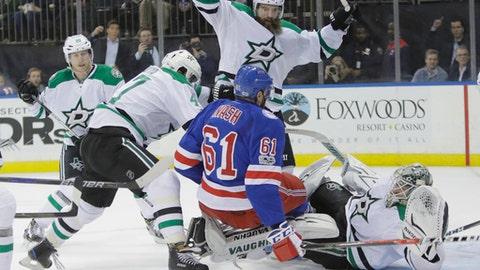 Dallas Stars' Patrik Nemeth (15) knocks down New York Rangers' Rick Nash (61) as goalie Antti Niemi (31) watches during the second period of an NHL hockey game Tuesday, Jan. 17, 2017, in New York. (AP Photo/Frank Franklin II)