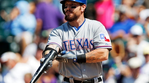 FILE - In this July 22, 2015, file photo, Texas Rangers' Josh Hamilton gets set to bat against the Colorado Rockies during a baseball game in Denver. Hamilton, the 2010 AL MVP who has had surgery three times on his left knee since last playing in 2015, knows he has to earn a spot on the Rangers' roster this spring. The five-time All-Star outfielder will also be learning a new position. (AP Photo/David Zalubowski, File)