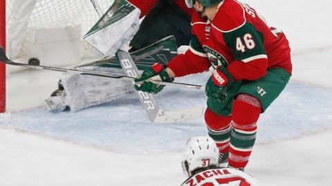 New Jersey Devils' Pavel Zacha, bottom, of the Czech Republic, watches his power-play goal against Minnesota Wild goalie Devan Dubnyk during the second period of an NHL hockey game Tuesday, Jan. 17, 2017, in St. Paul, Minn. (AP Photo/Jim Mone)