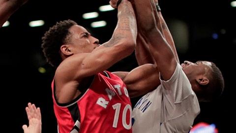 Toronto Raptors guard DeMar DeRozan (10) shoots against Brooklyn Nets guard Caris LeVert during the second quarter of an NBA basketball game, Tuesday, Jan. 17, 2017, in New York. (AP Photo/Julie Jacobson)