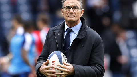 FILE - In this Sunday, March 13, 2016 file photo, France's head coach Guy Noves looks on ahead of their Six Nations rugby union international match at Murrayfield stadium, Edinburgh, Scotland. France coach Guy Noves has selected four uncapped players and recalled center Yann David for his Six Nations squad ahead of the opening game away to defending champion and Grand Slam winner England on Feb. 4. Lock Arthur Iturria, prop Mohamed Boughanmi, backrower Fabien Sanconnie and fullback Geoffrey Palis are the newcomers. (AP Photo/Scott Heppell, file)