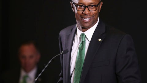 FILE - In this Dec. 8, 2016, file photo, new University of Oregon NCAA college football coach Willie Taggart takes questions during an introductory press conference in Eugene, Ore. The University of Oregon suspended football strength and conditioning coach Irele Oderinde one month without pay after three players were hospitalized following a series of intense workouts last week. The school announced the decision in a statement Tuesday evening, Jan. 17, 2017,  and detailed a review of the incident. It added that all future workouts have been modified and the strength and conditioning coach will now report to director of performance and sports science Andrew Murray instead of coach Willie Taggart, who apologized in the statement. (Chris Pietsch/The Register-Guard via AP, File)