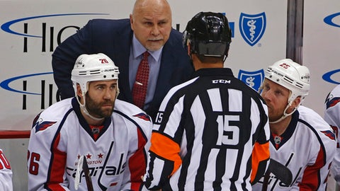 FILE - In this May 4, 2016 file photo, Washington Capitals head coach Barry Trotz talks to Referee Jean Hebert, (15), during the first period of Game 4 against the Pittsburgh Penguins in an NHL hockey Stanley Cup Eastern Conference semifinals in Pittsburgh. Shut up and play has been a mantra for the Washington Capitals lately. Too often early in the season players would harp on officials for missing a penalty or getting a call wrong. So coach Barry Trotz and veteran leaders made a concerted effort to tone down on the yapping. (AP Photo/Gene J. Puskar, File)
