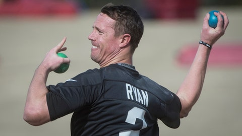 Atlanta Falcons quarterback Matt Ryan warms up during practice, Wednesday, Jan. 18, 2017, in Flowery Branch, Ga. The Falcons host the Green Bay Packers in the NFC Championship football game on Sunday. (AP Photo/John Amis)