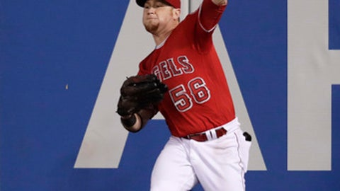 Los Angeles Angels' Kole Calhoun throws to third base after catching a fly ball hit by Houston Astros' Jose Altuve during the third inning of a baseball game, Saturday, Oct. 1, 2016, in Anaheim, Calif. (AP Photo/Jae C. Hong)