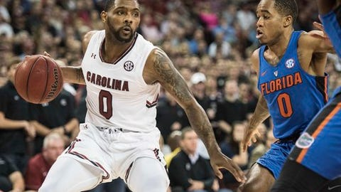 South Carolina guard Sindarius Thornwell (0) dribbles against Florida guard Kasey Hill (0) during the first half of an NCAA college basketball game Wednesday, Jan. 18, 2017, in Columbia, S.C. (AP Photo/Sean Rayford)