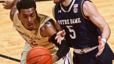 Florida State guard Xavier Rathan-Mayes (22) steals the ball from Notre Dame guard Matt Farrell (5) in the first half of an NCAA college basketball game on Wednesday, Jan. 18, 2017, in Tallahassee, Fla. (AP Photo/Phil Sears)