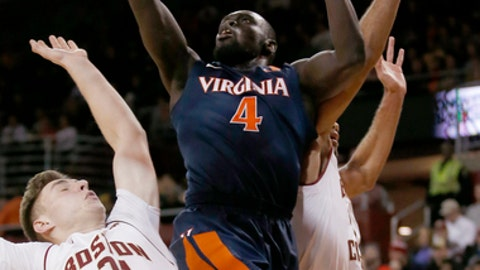 Virginia guard Marial Shayok (4) shoots against the defense of Boston College forward Nik Popovic (21) and guard Jerome Robinson (1) during the first half of an NCAA college basketball game in Boston, Wednesday, Jan. 18, 2017. (AP Photo/Mary Schwalm)