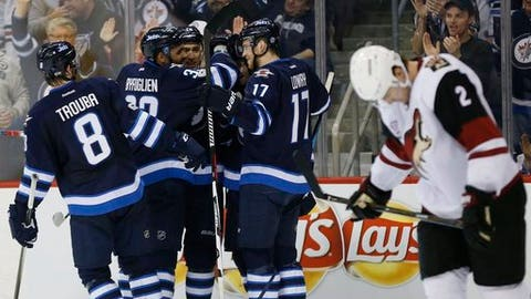 Winnipeg Jets' Jacob Trouba (8), Dustin Byfuglien (33), Shawn Matthias (16), Joel Armia (40) and Adam during the second period of an NHL hockey game Wednesday, Jan. 18, 2017, in Winnipeg, Manitoba. (John Woods/The Canadian Press via AP)