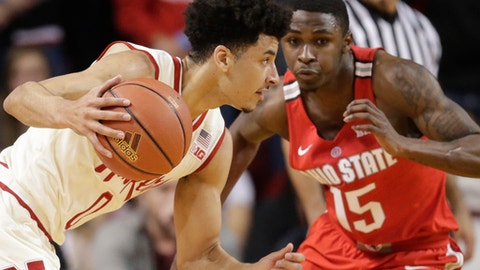 Nebraska's Tai Webster, left, drives past Ohio State's Kam Williams (15) during the first half of an NCAA college basketball game in Lincoln, Neb., Wednesday, Jan. 18, 2017. (AP Photo/Nati Harnik)