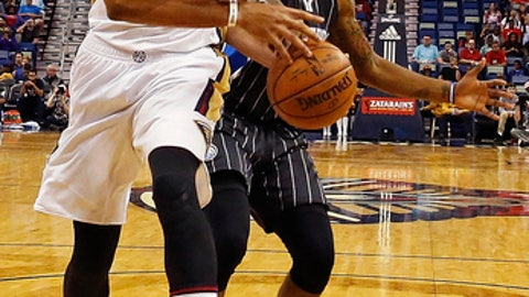New Orleans Pelicans forward Anthony Davis, left, is fouled by Orlando Magic guard Elfrid Payton, right, in the first half of an NBA basketball game in New Orleans, Wednesday, Jan. 18, 2017. (AP Photo/Max Becherer)