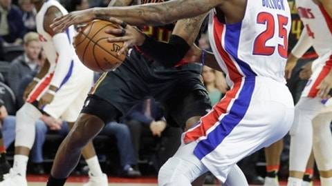 Atlanta Hawks forward Kent Bazemore, left, an d Detroit Pistons forward Reggie Bullock (25) reach for a rebound during the first half of an NBA basketball game, Wednesday, Jan. 18, 2017, in Auburn Hills, Mich. (AP Photo/Carlos Osorio)