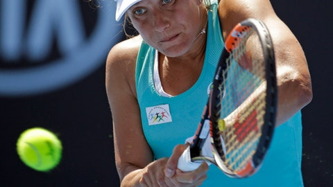 Barbora Strycova of the Czech Republic makes a backhand return to Germany's Andrea Petkovic during their second round match at the Australian Open tennis championships in Melbourne, Australia, Thursday, Jan. 19, 2017. (AP Photo/Aaron Favila)