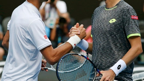 Uzbekistan's Denis Istomin, right, is congratulated by Serbia's Novak Djokovic after winning their second round match at the Australian Open tennis championships in Melbourne, Australia, Thursday, Jan. 19, 2017. (AP Photo/Mark Baker)