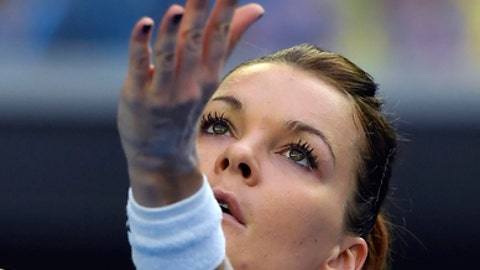 Poland's Agnieszka Radwanska serves to Croatia's Mirjana Lucic-Baroni during their second round match at the Australian Open tennis championships in Melbourne, Australia, Thursday, Jan. 19, 2017. (AP Photo/Andy Brownbill)