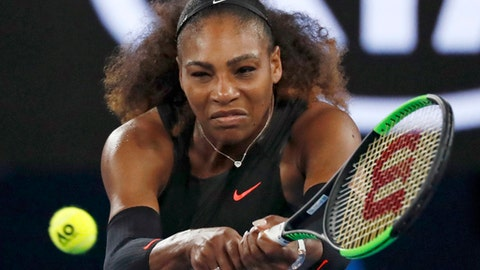 United States' Serena Williams makes a backhand return to Lucie Safarova of the Czech Republic during their second round match at the Australian Open tennis championships in Melbourne, Australia, Thursday, Jan. 19, 2017. (AP Photo/Kin Cheung)