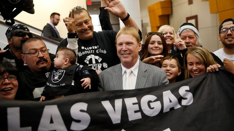FILE - In this April 28, 2016, file photo, Oakland Raiders owner Mark Davis, center, meets with Raiders fans after speaking at a meeting of the Southern Nevada Tourism Infrastructure Committee in Las Vegas. The Raiders have filed paperwork to move to Las Vegas. Clark County Commission Chairman Steve Sisolak told The Associated Press on Thursday, Jan. 19, 2017,  that he spoke with the Raiders. (AP Photo/John Locher, File)