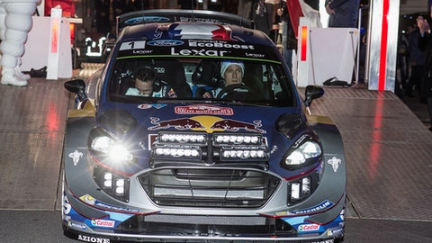 Sebastien Ogier of France, right, and his co driver Julien Ingrassia of France steering a Ford Fiesta WRC start the 85th Rally of Monte Carlo, Thursday, Jan. 19, 2017, in Monaco. The Rally of Monte Carlo is the first event of the 2017 FIA World Rally Championship calendar. (AP Photo/Christian Alminana)