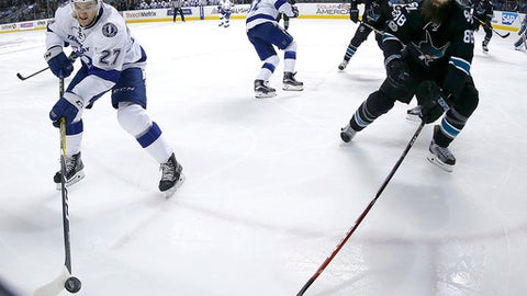 Tampa Bay Lightning left wing Jonathan Drouin (27) and San Jose Sharks defenseman Brent Burns (88) chase the puck during the second period of an NHL hockey game, Thursday, Jan. 19, 2017, in San Jose, Calif. (AP Photo/Tony Avelar)