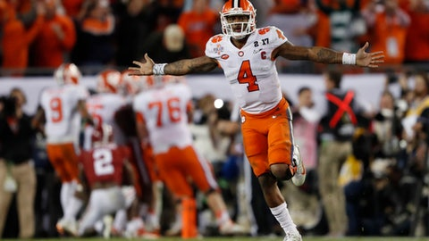 FILE - In this Jan. 10, 2017, file photo, Clemson's Deshaun Watson celebrates a last second touchdown pass to Hunter Renfrow during the second half of the NCAA college football playoff championship game against Alabama, in Tampa, Fla. The NFL on Friday, Jan. 20, 2017, released a list of 95 underclassmen who have been granted early entry to the draft, along with the names of eight other players, including Clemson quarterback Deshaun Watson, who are draft-eligible by completing their college degrees. (AP Photo/John Bazemore, File)