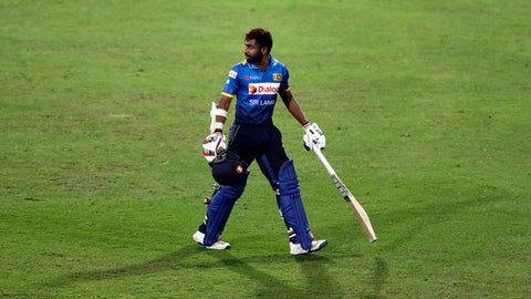 Sri Lanka's batsman Niroshan Dickwella, leaves the field after dismissed by South Africa's bowler Imran Tahir, for 27 runs during the T20 cricket match between South Africa and Sri Lanka, at Centurion Park in Pretoria, South Africa, Friday, Jan. 20, 2017. (AP Photo/Themba Hadebe)