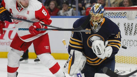 Buffalo Sabres goalie Anders Nilsson (31) makes a save against Detroit Red Wings forward Justin Abdelkader (8) during the second period of an NHL hockey game, Friday, Jan. 20, 2017, in Buffalo, N.Y. (AP Photo/Jeffrey T. Barnes)