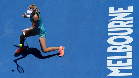 Russia's Ekaterina Makarova makes a forehand return to Slovakia's Dominika Cibulkova during their third round match at the Australian Open tennis championships in Melbourne, Australia, Saturday, Jan. 21, 2017. (AP Photo/Aaron Favila)