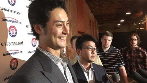 Texas Rangers pitcher Yu Darvish, left, smiles while speaking to reporters Friday, Jan. 20, 2017, at the team's winter banquet in Dallas. Darvish is going into the final season of the six-year contract he signed with the Rangers after seven seasons in Japan. The 30-year-old Darvish, who missed all of 2015 after Tommy John surgery and didn't make his debut last season until the end of May, says he wants to prove to the Rangers how good of a pitcher he is. (AP Photo/Stephen Hawkins)