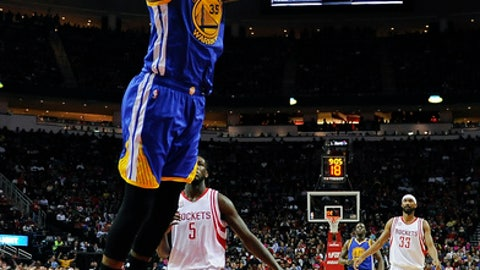 Golden State Warriors forward Kevin Durant (35) dunks during the second half of the team's NBA basketball game, Friday, Jan. 20, 2017, in Houston. Golden State won 125-108. (AP Photo/Eric Christian Smith)