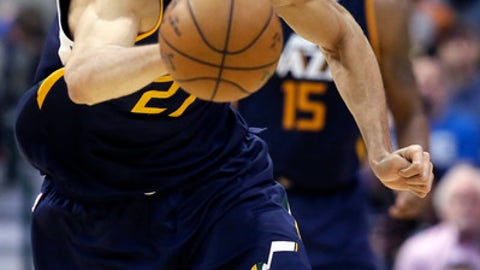 Utah Jazz center Rudy Gobert starts the fast break after coming up with a steal during the second half of the team's NBA basketball game against the Dallas Mavericks in Dallas, Friday, Jan. 20, 2017. The Jazz won 112-107 in overtime. (AP Photo/LM Otero)