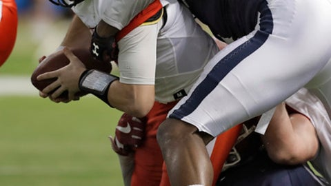 East quarterback Nick Mullens, (9), of Southern Mississippi, gets sacked by West defensive end Darius English, (90), of South Carolina, during the first half of the East West Shrine football game Saturday, Jan. 21, 2017, in St. Petersburg, Fla. (AP Photo/Chris O'Meara)