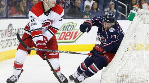 Carolina Hurricanes' Brett Pesce, left, tries to clear the puck past Columbus Blue Jackets' Cam Atkinson during the second period of an NHL hockey game Saturday, Jan. 21, 2017, in Columbus, Ohio. (AP Photo/Jay LaPrete)