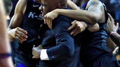 Kansas State players Kamau Stokes, left, and Carlbe Ervin II, right, celebrate following an NCAA college basketball game against West Virginia in Manhattan, Kan., Saturday, Jan. 21, 2017. Kansas State defeated West Virginia 79-75. (AP Photo/Orlin Wagner)