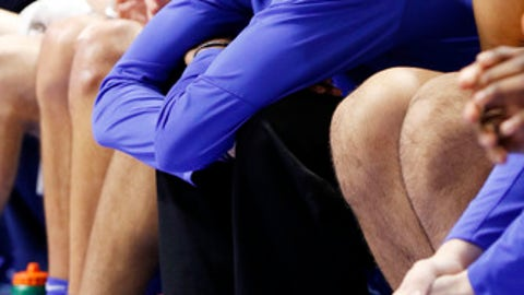 Kentucky's De'Aaron Fox sits on the bench during the second half of an NCAA college basketball game against South Carolina after injuring his ankle in the first half, Saturday, Jan. 21, 2017, in Lexington, Ky. Kentucky won 85-69. (AP Photo/James Crisp)